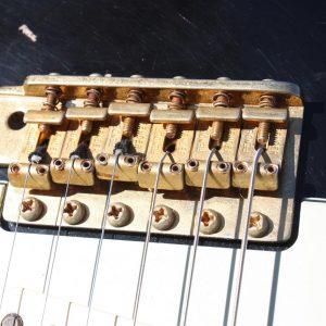 Vue d'un réglage de hauteur de cordes
